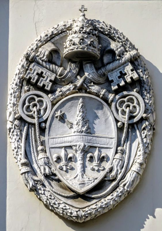 Coat of arms of Pope Leo XIII (r. 1878-1903), facade of the church of Ss Sergio e Bacco, Rome